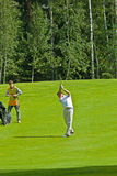 Golfer from Jupan finishes his swing Stock Images