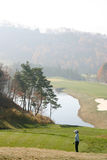Golfer in Korea. A golfer on a course in the Korean mountains. (Phoenix Park course stock images