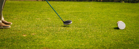 Golfer lines up his driver. Golfer lining up his tee shot in prince edeward island Stock Photo