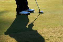 Golfer Lines Up His Putt Royalty Free Stock Photo
