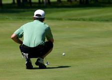 Golfer Lines Up His Putt Stock Images