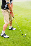 Golfer lining up his shot Royalty Free Stock Photo