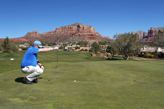 Golfer Lining up a Putt. A golfer lining up a short putt in scenic sedona arizona Royalty Free Stock Images