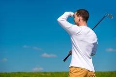 Golfer looking afar trajectory of flying his ball Stock Photography