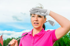 Golfer looks into the ball flying high Royalty Free Stock Image