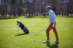Golfer man with his bag Stock Photography