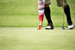 Golfer mark  his position ball Royalty Free Stock Photo