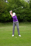 Golfer mid iron backswing Royalty Free Stock Images