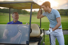 Golfer near golf cart Royalty Free Stock Image