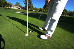 Golfer On Putting Green Royalty Free Stock Photos
