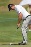 Golfer Padraig Harrington Putts. Professional Padraig Harrington putts golf ball at the European PGA Tournament Volvo Golf Champions Tournament action at Durban Royalty Free Stock Photos