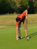 Golfer picking. A golfer who picks up his ball Royalty Free Stock Images