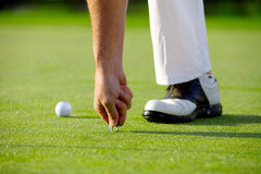 Golfer with pitchfork Royalty Free Stock Images