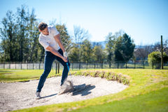 Free Golfer Playing A Chip Shot Onto The Green Stock Image - 77054751