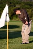 Golfer playing chip shot Royalty Free Stock Images