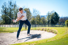 Golfer playing a chip shot onto the green Royalty Free Stock Photos