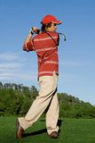 Golfer playing golf. Swinging club Royalty Free Stock Photography