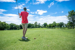 Golfer playing golf Stock Images