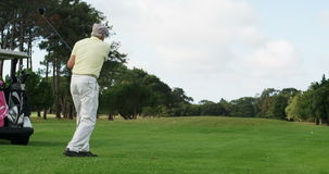 Golfer playing golf. At golf course stock video