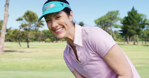 Golfer playing golf. At golf course stock footage