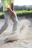 Golfer playing out of a sand trap Royalty Free Stock Images