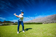 Golfer playing a shot on the fairway. Close up image of a male golfer playing a shot on the fairway on a golf course in south africa stock photo