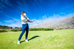 Golfer playing a shot on the fairway Royalty Free Stock Image