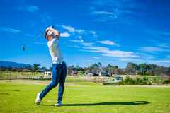 Golfer playing a shot on the fairway Royalty Free Stock Photo