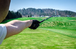 Golfer is pointing witha a golf club. Showing a direction and me Stock Photo