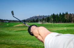 Golfer is pointing witha a golf club Royalty Free Stock Photography
