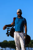 Golfer  portrait at golf course on sunset Royalty Free Stock Photo