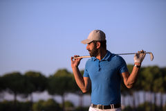 Golfer  portrait at golf course on sunset Stock Images