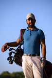 Golfer  portrait at golf course on sunset Royalty Free Stock Image