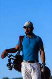 Golfer  portrait at golf course on sunset. Handsome middle eastern golfer portrait at golf course at beautiful sunset Royalty Free Stock Image