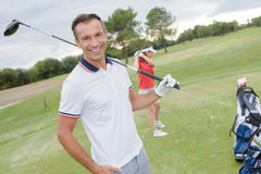 Golfer posing for picture Stock Photography