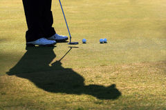 Golfer Practices His Putt Royalty Free Stock Images