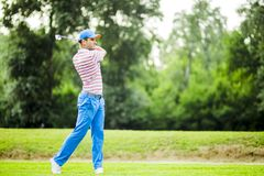 Golfer practicing and concentrating before and after shot Stock Image