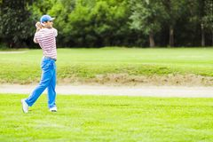 Golfer practicing and concentrating before and after shot Stock Images