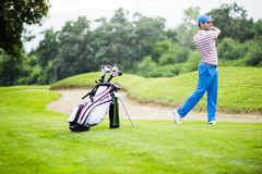 Golfer practicing and concentrating before and after shot Royalty Free Stock Image
