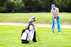 Golfer practicing and concentrating before and after shot Stock Photos