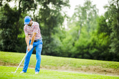 Golfer practicing and concentrating before and after shot Royalty Free Stock Photos