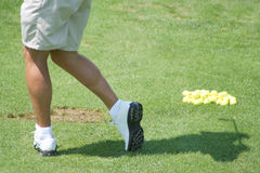 Golfer Practicing Drive. Golfer Practicing on a Driving Range Royalty Free Stock Photography