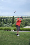 Golfer practicing swing Stock Photography