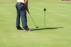 Golfer practising putting Stock Photos