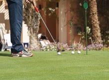 Golfer practising putting Stock Photos