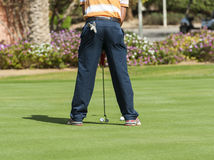Golfer practising putting Stock Photo