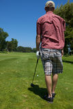Golfer Preparing to Swing. A golf player preparing to swing lining up shot Royalty Free Stock Photos