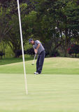 Golfer in putt Stock Photography