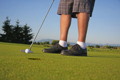 Golfer putting Royalty Free Stock Images