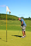 Golfer putting. On the green Stock Photo